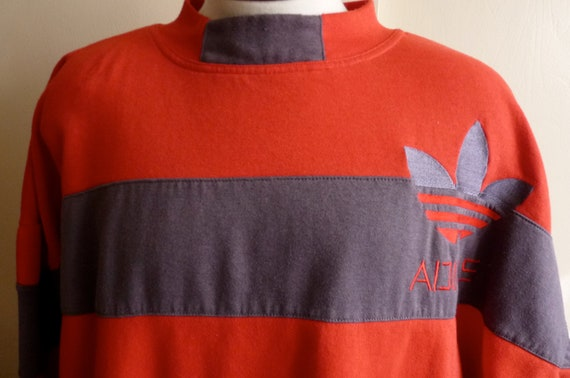 vintage 80's/90's Adidas embroidered tre-foil color block rugby stripe orange red and grey stripes front pocket huge crew neck fleece sweats