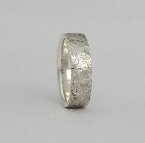 Size 4 sterling silver with rustic texture, number 230.
