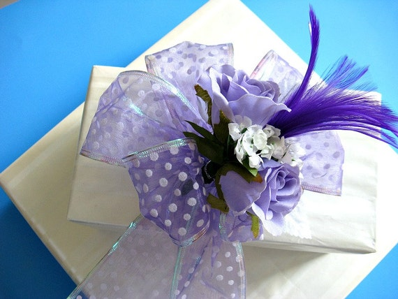 Purple and white all occasion bow with purple feather (GN35)