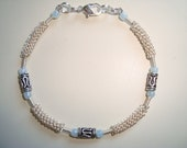 Silver plated minimalist wire bracelet with blue glass beads and silver beads