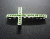 Silver with Green rhinestone sideways cross