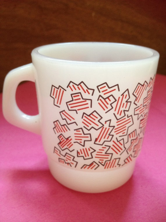 milk glass mug with red 80s keith haring style pattern