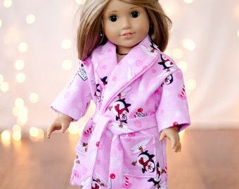 From Santa American Girl Doll pink flannel North Pole penguin robe with matching slippers, and pink pajamas