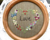 """Framed embroidery """"love"""" with hand embroidered flowers"""