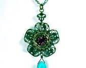Sale - Amethyst-toned Swarovski crystal and antiqued brass flower filigree pendant with natural turquoise.