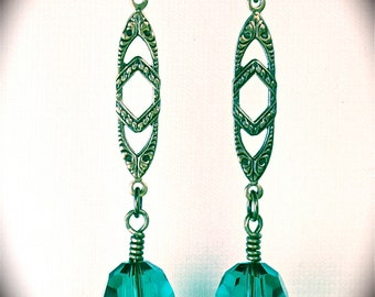 Long brass filigree earring with Swarovski fern green crystal capped with vintage brass filigree.