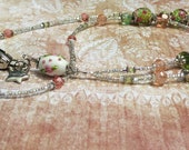 Beautiful lampwork and peach and green crystal beaded lanyard