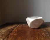 Geometric faceted porcelain vessel