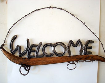 Welcome sign on antique harness hame.