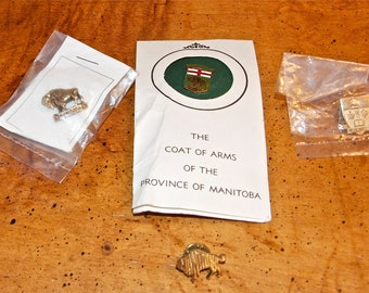 Four vintage Manitoba pins...buffalo pins.