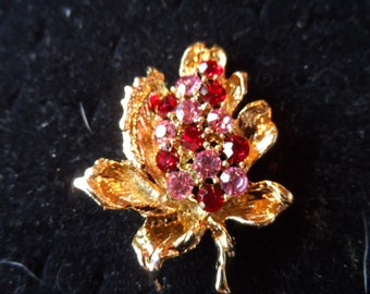 Sparkling Red and Pink Rhinestones on Gold Tone Pin on Leaf