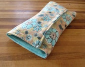 Changing Pad Clutch in Blue and Gold Hawaiian Floral Print