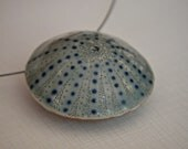 Ocean inspired- Ceramic pendant necklace sea urchin with blue and glass details-DOUBLE SIDED-