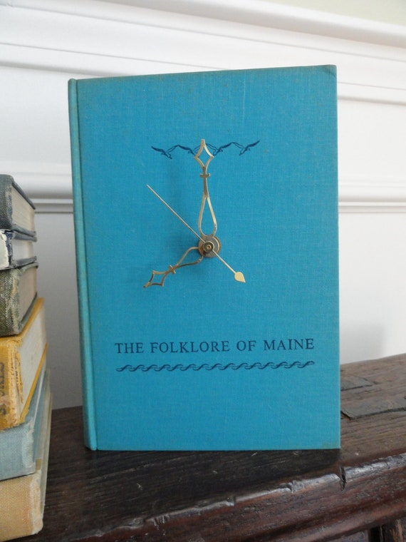 Book Clock, The Folklore of Maine, turquoise blue cover with navy blue title & seagulls, brass clock hands