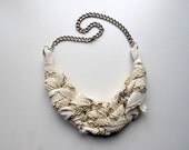 """Beautiful handmade """"Shades of White"""" necklace with green details. Featured in Belle Armoire Magazine."""