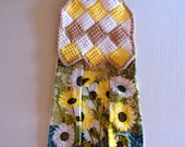 These daisies are complimented by yellow, tan and white yarn.  Crocheted with 100% cotton.