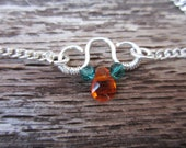 Delicate silver bracelet with bright orange and teal beads