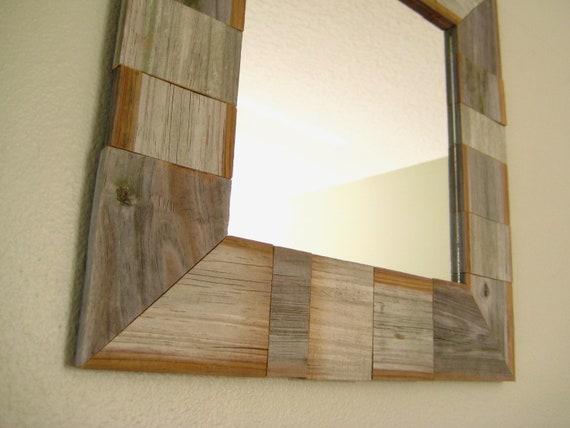 mirror in a handmade fence slat frame