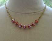 Faceted red glass and brown bronze beaded necklace by Cerise Jewelry
