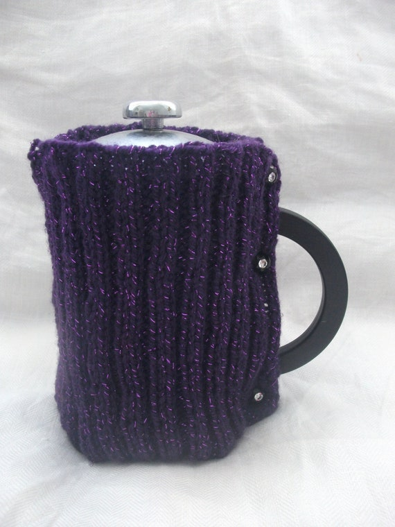 Purple sparkly coffee cosy