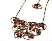 Cranberry delights, necklace made with red czech glass beads, Picasso, opaque, faceted crystals and antiqued brass irregular shapes - BBTAR