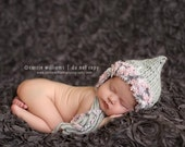 Knitted grey and pink bonnet