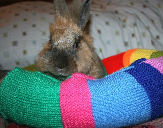 Ugli Donut bunny bed for a medium sized bunny hand knitted bright stripes