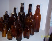 1890-1950's Lot of 20 Amber Plain and Embossed  bottles 1 3/8  to 11 3/8  inches NY