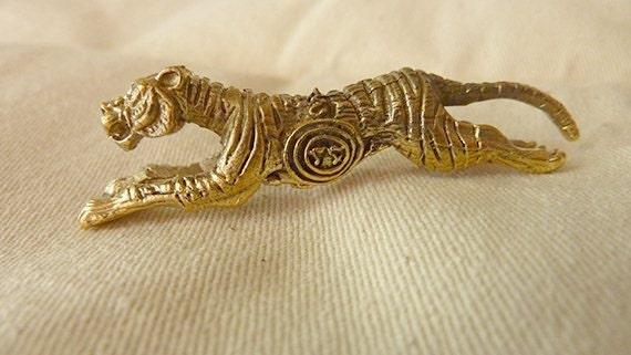 Vintage Thai running tiger  in golden brass