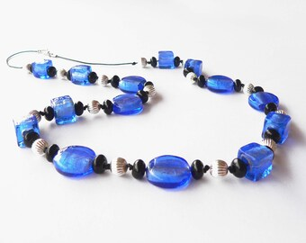Blue statement necklace handmade with blue and black glass beads and metal beads. ooak made in Italy.