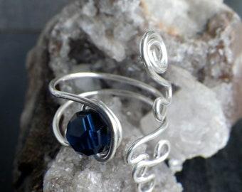 Sterling silver swirly ring with dark indigo Swarovski crystal