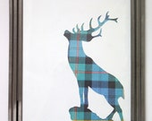 Och Aye- A Stag Reverse Silhouette with a Blue and Green Tartan Pattern. In a 9x7 Metal Frame.