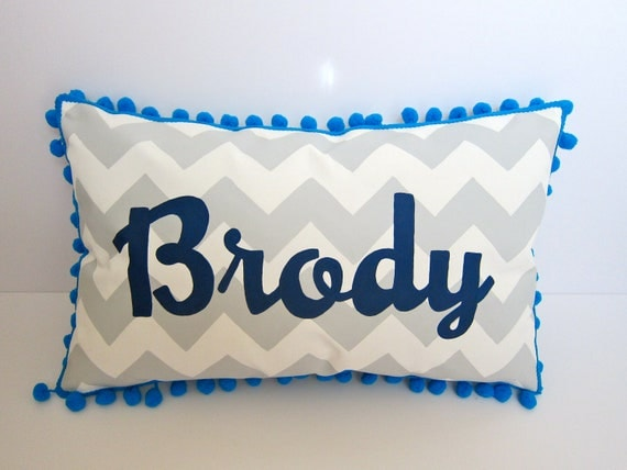 Baby pillow in light gray chevron. Personalized name in navy blue script.