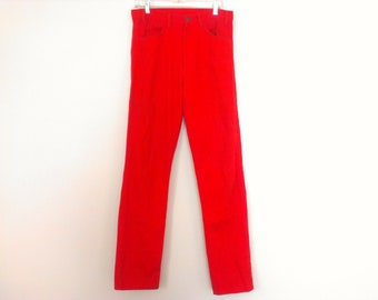 80s vintage red Levis 33x34 width/length, light spots, scuffed fabric of left back pocket