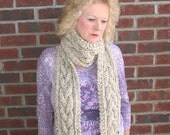 Big Lou Hand Knit Plait Cable Twist Scarf in a Color called Oatmeal