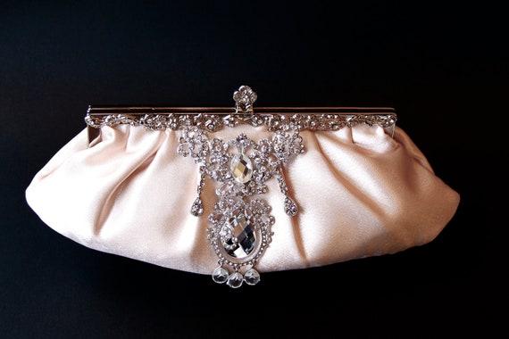 Pink Champaign Satin Bridal Clutch with a stunning Swarovski crystal rhinestone accent