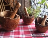 "Mortar and pestle made out of olive wood - handmade - small Version right on the picture (ca 4"" in diamter)"