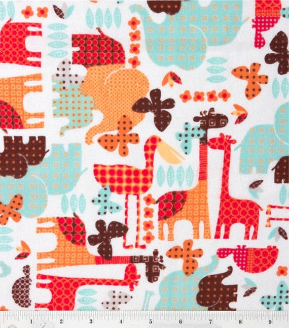 Jungle Geometric Flannel Fabric animal silhouettes in red orange blue brown with dots and squares - YARD