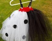 Cruella Deville/101 Dalmatians Inspired Tutu(size 3-5). Half black, half white with Dalmatian polka dots and buttons.