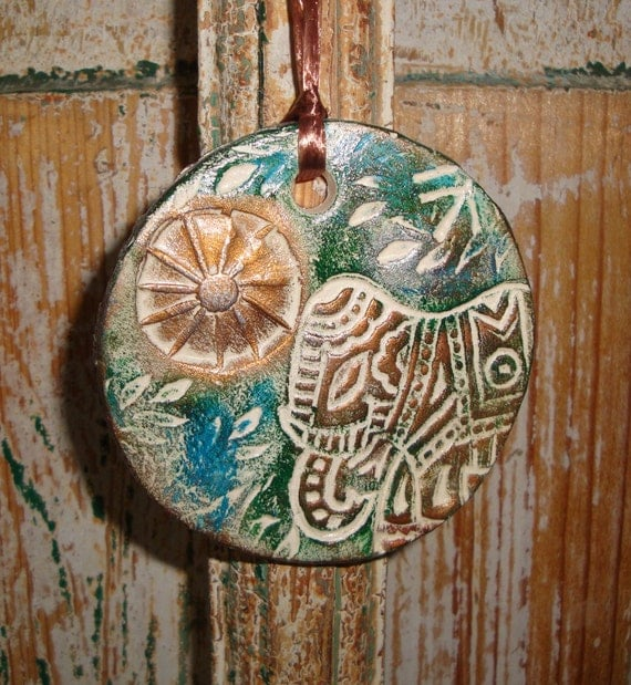 RESERVED FOR HEATHER   Stamped Pottery Ornament Elephant and Sun in Copper and Verdigris Gilders Paste