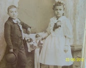 Brother and Sister Posing in a Studo in Fine Victorian Clothes  Preucel and Mally Studio Chicago Illinois