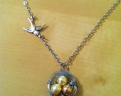 Flying sparrow and bird nest pendant necklace