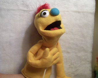 Yellow hand puppet with mohawk