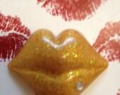 Golden lip cabochon