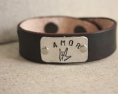 "Leather cuff bracelet with ""Amor"" stamp"