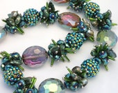 Chinese Crystal Beads Designer Glass Faceted Oval Beads in Green with FREE Crystal Beads