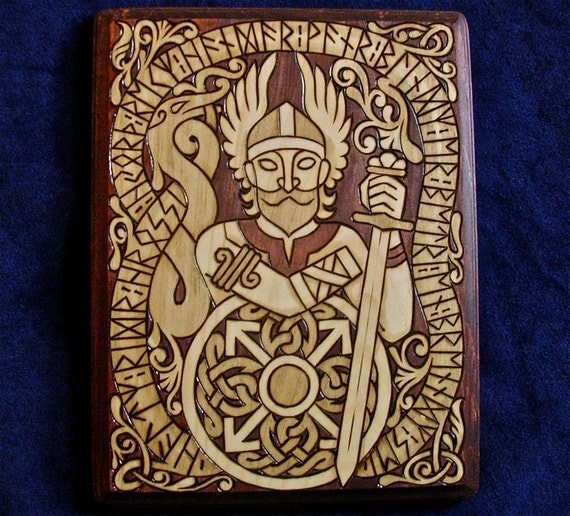 Tyr the one-handed Viking god with inscription in Runes wood