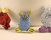 Set of 3 scary monster magnets. 3D.