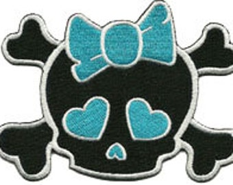 skull with blue bow patch