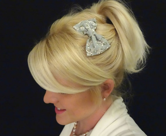 Pair of two light grey and white floral bow hair clips feminine/adult/child